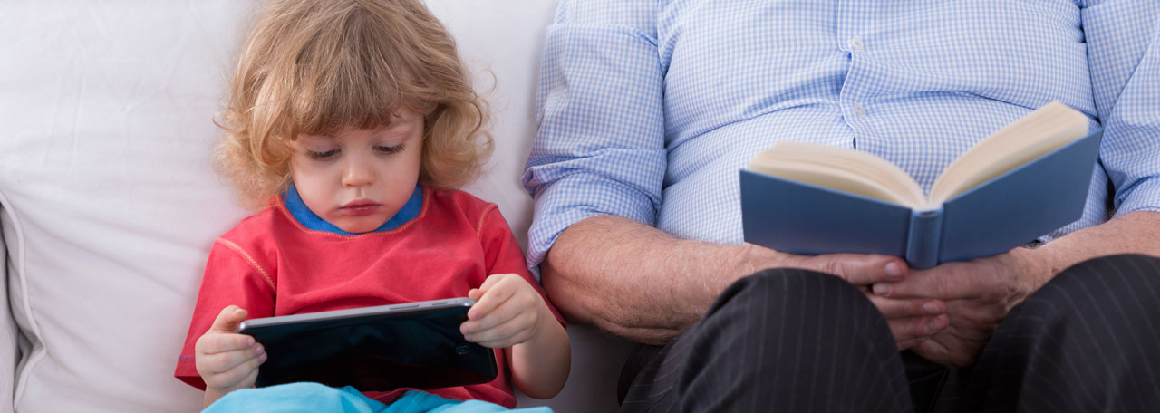 Man and child read book and tablet